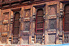 house facade with intricate wood carvings in almora (india), almora, carved, facade, house, intricate, low relief, windows, wood carving, wooden