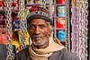 chain merchant in his chains store (india), almora, chains, hardware, knitcap, man, market, merchant, metal, scarf, shop, store, tilak, tilaka