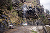 car gets shower from waterfall - gangotri road (india), 4x4, bhagirathi valley, car, dripping, jeep, motorbike, motorcycle, mountain road, mountains, overhanging rock, shower, water