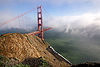 golden gate bridge in the fog - view from the spencer battery (san francisco), beach, bridge tower, cliff, fog, golden gate bridge, ocean, sea, seashore, shore, suspension bridge, water