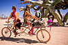 symmetrical tandem bike - burning man 2015, burning man, riding, symmetrical, tandem bicycle, tandem bike, two, women