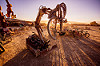 tracked hydraulic robot crushing bicycle - subjugator - burning man 2015, art, bicycle, burning man, christian ristow, grapple attachment, hydraulic arm, hydraulic grapple, machine, machinery, mechanical, robot, shadows, subjugator