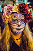 woman with purple and white sugar skull makeup and flower headdress - dia de los muertos, day of the dead, dia de los muertos, face painting, facepaint, flower headdress, flowers, halloween, neckless, night, purple, sugar skull makeup, woman