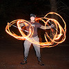 eric spinning fire staffs (san francisco), double staff, fire dancer, fire dancing, fire performer, fire spinning, fire staffs, fire staves, flames, long exposure, night, spinning fire
