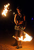 spinning fire staff (san francisco) - fire dancer - leah, androgynous, desert party, fire dancer, fire dancing, fire performer, fire spinning, fire staffs, fire staves, flames, leah, night, psy trance, rave party, spinning fire, tattooed, tattoos, woman