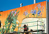 noe valley mural by mona caron  (san francisco), artichoke, flowers, mona caron, mural, orange, paint, painter, painting, scaffolding, wall