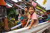 kids in pickup truck - parading the giant bamboo fireworks rocket - vang vieng (laos)