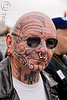 face tattoo, bald, dore alley fair, face tattoos, full face tattoo, man, nose piercing, septum piercing, skin, sunglasses, tattooed, tribal tattoo