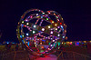 animated steel rings sculpture with LED lights - burning man 2016, animated, art installation, burning man, disc-go-sphere, glowing, led light, metal, night, sculpture, the man
