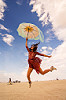 woman jumping with umbrella - burning man 2016, burning man, danielle, jump shot, red dress, umbrella, woman