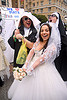 bride with nuns - diana furka - brides of march (san francisco), bridal bouquet, brides of march, diana furka, festival, flowers, wedding dress, white roses, woman