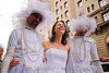 woman laughing between two men dressed as brides - brides of march (san francisco), brides of march, festival, men, necklaces, wedding dress, white, woman