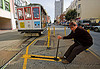 cable car switch - powell street (san francisco), cable car, man, muni worker, powell st, powell street, railroad switch, railroad tracks, rails, railway tracks, the point
