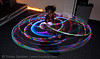 joy spinning a LED hula hoop (san francisco), glowing, hula hooping, joy, led hoop, led hula hoop, led lights, led-light, light hoop, long exposure, night, people, spinning