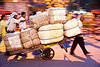 porters with heavy load of freight - delhi (india)