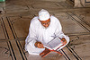 mulsim man reading the quran in mosque - delhi (india)