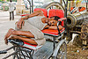 cycle rickshaw driver sleeping near gun - jaipur (india)