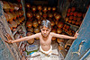 boy guarding water-pots shop - jaipur (india)