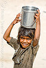little girl carrying water (india)