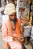 sadhu (hindu holy man) shopping for a cobra scupture for his temple - udaipur (india)