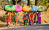 women in sari carrying bags (india)