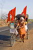 hindu pilgrim on cycle rickshaw (india)