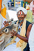 sadhu (hindu holy man) with cow - orchha (india)