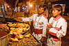 members of marching band buying samosas - orchha (india)