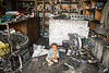 baby in motorcycle mechanic shop - keylong - manali to leh road (india)