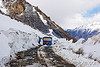 truck, mud and snow on the road - khardungla pass - ladakh (india)