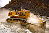 bulldozer clearing boulders - road construction - ladakh (india)