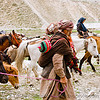 old man with baby - nomads with horses - drass valley - leh to srinagar road - kashmir