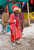 sadhu (hindu holy man) with large red hat - amarnath yatra (pilgrimage) - kashmir