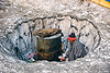 man heating water in a barrel - amarnath yatra (pilgrimage) - kashmir