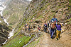 pilgrim on dandi / doli (chair carried by 4 porters) - pilgrims on trail - amarnath yatra (pilgrimage) - kashmir