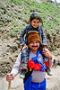 father with young daughter on his shoulder - pilgrim on trail - amarnath yatra (pilgrimage) - kashmir