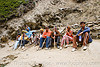pilgrims with walking sticks resting on trail - amarnath yatra (pilgrimage) - kashmir
