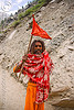 sadhu (hindu holy man) with red flag on trail - amarnath yatra (pilgrimage) - kashmir