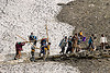 pilgrims on dandis / dolis (chairs carried by 4 porters) on trail - amarnath yatra (pilgrimage) - kashmir