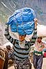 young porter carrying heavy load on his head - amarnath yatra (pilgrimage) - kashmir