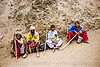 exhausted and dusty family resting on trail - amarnath yatra (pilgrimage) - kashmir