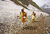 bare-feet sadhus (hindu holy men) on glacier trail - amarnath yatra (pilgrimage) - kashmir