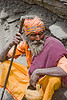 dusty sadhu (hindu holy man) resting on trail - amarnath yatra (pilgrimage) - kashmir