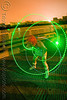 green laser hulahoop - superhero street fair (san francisco), green laser, islais creek promenade, laser hoop, laser hula hoop, long exposure, night, superhero street fair, woman