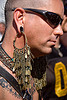 man with large bronze earring - dore alley fair (san francisco)