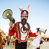 steven raspa is the uber bunny, leading the bunny march - burning man 2009, beard, bullhorns, bunnies, bunny ears, bunny march, burning man, cap, color contact lenses, contacts, costume, hat, makeup, red, special effects contact lenses, steven raspa, theatrical contact lenses