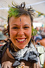 woman with bindis and green hair - burning man 2009, bandana, bindis, burning man, gauged ears, green hair, piercing, sky nebeulah, woman