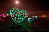EL-wire heart and full moon - burning man 2009, art, bicycle, bike, burning man, el-wire heart, full moon, green heart, james hacking, mesh, night
