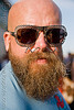 bearded man with sunglasses and nose piercing - dusti cunningham aka diablodivine, bald head, beard, diablodivine, dusti cunningham, folsom street fair, man, nose piercing, septum piercing, sunglasses