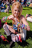 kandi kid with cuffs making heart sign, beads, blonde, clothing, cross-legged, fashion, festival, heart sign, kandi bracelets, kandi cuffs, kandi kid, kandi raver, love fest, lovevolution, plur, sitting, woman